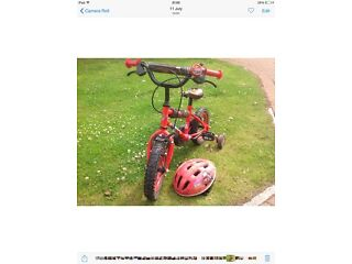 Kiddies Lightning McQueen bike and matching helmet in very good condition
