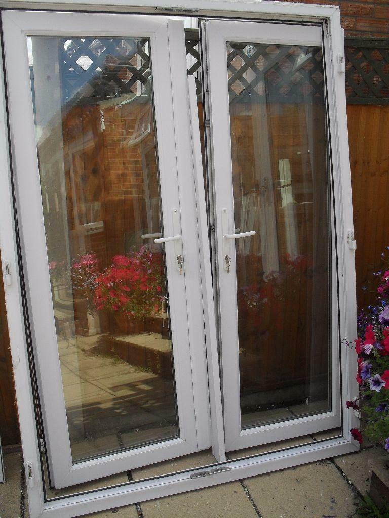 Rahul outward opening white upvc double glazed french for Upvc french doors inward opening