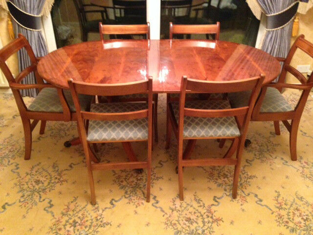 YEW VENEERED DINING TABLE AND 6 CHAIRS WITH EXTENSION LEAF