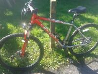 """Unisex Carrera18"""" mountain bike,24 speed,disc brakes, good suspension, just serviced rides like new"""