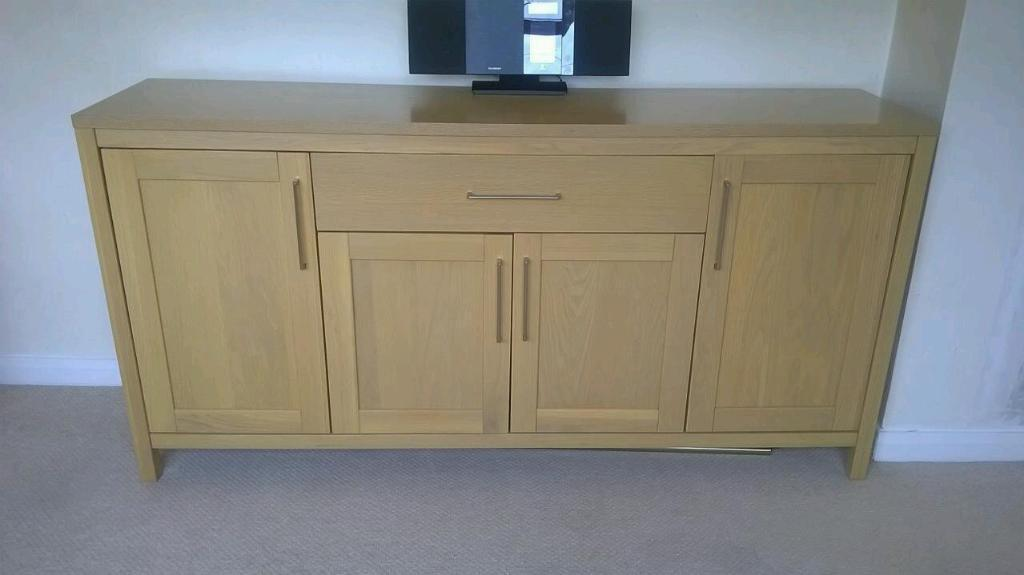 As new oak sideboard and dining table chairs
