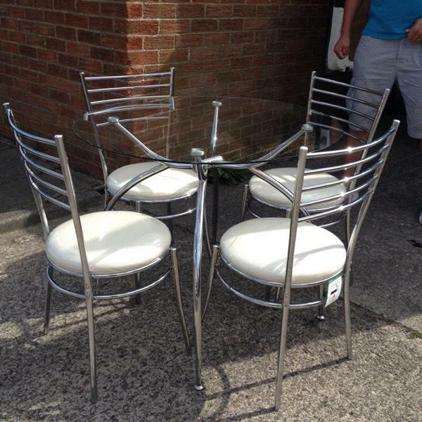 glass chrome table and chairs still with plastic covers