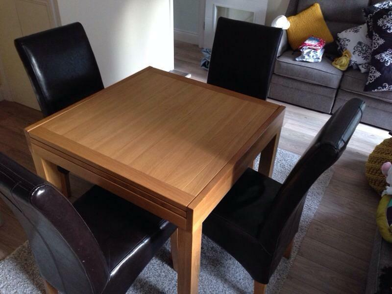 solid oak wood extending dining table and chairs united