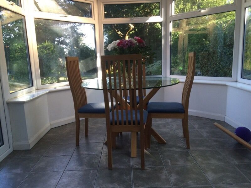 Round Glass Table With Wooden Legs And Four Chairs United Kingdom Gumtree