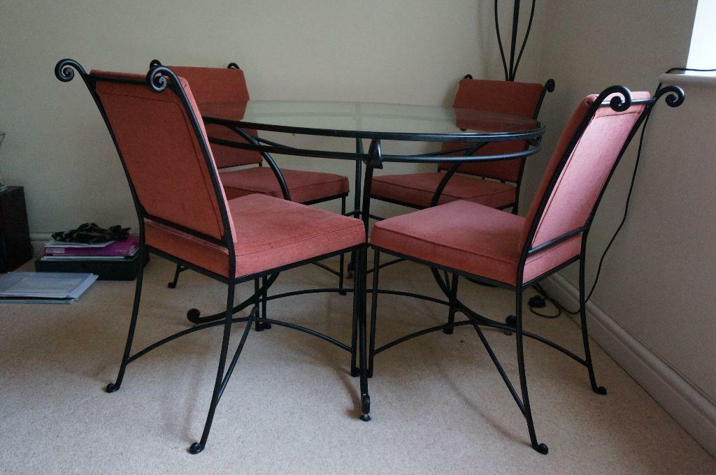 Lovely cast iron and glass dining table and four chairs for Cast iron and glass dining table