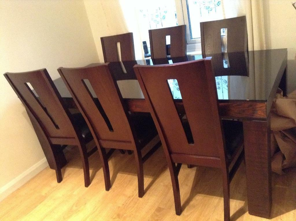 black glass topped table with 8 matching chairs united