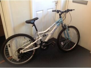 Bicycle for 8-12 year olds-nearly new but some faults in right brake and both wheels need pumping.