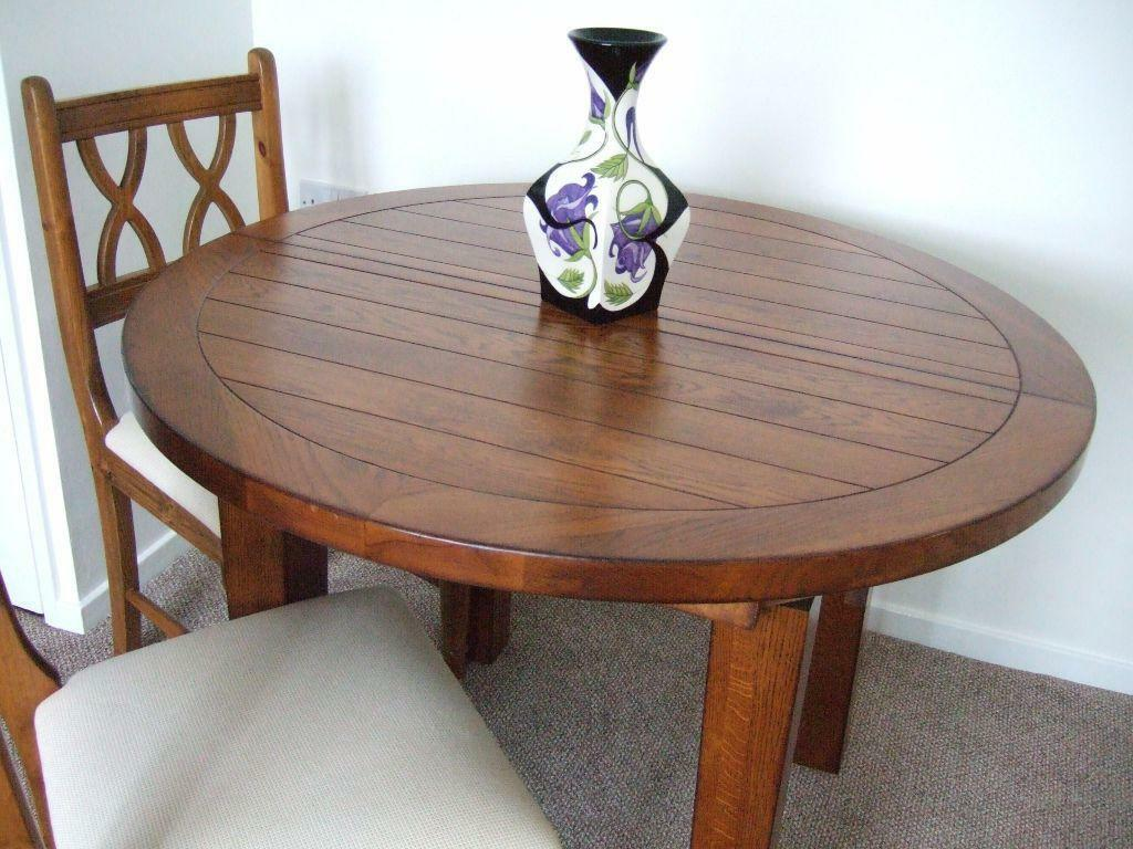 A genuine like new solid wood round extending dining table for Solid wood round dining table