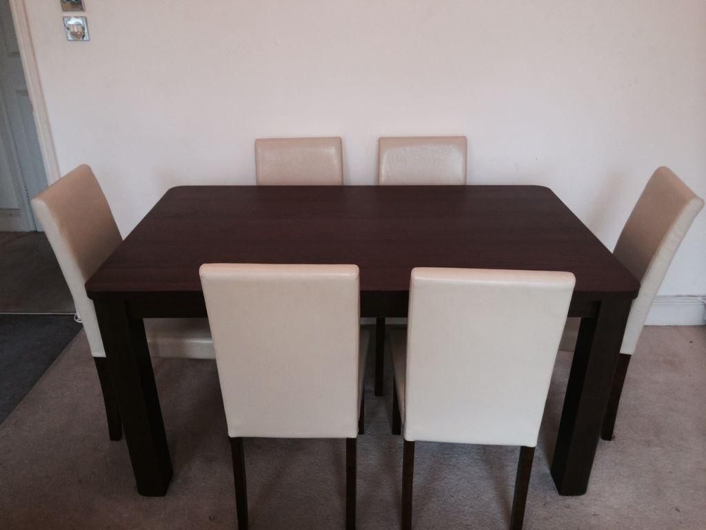 dark brown walnut wood 6 seater dining table and cream
