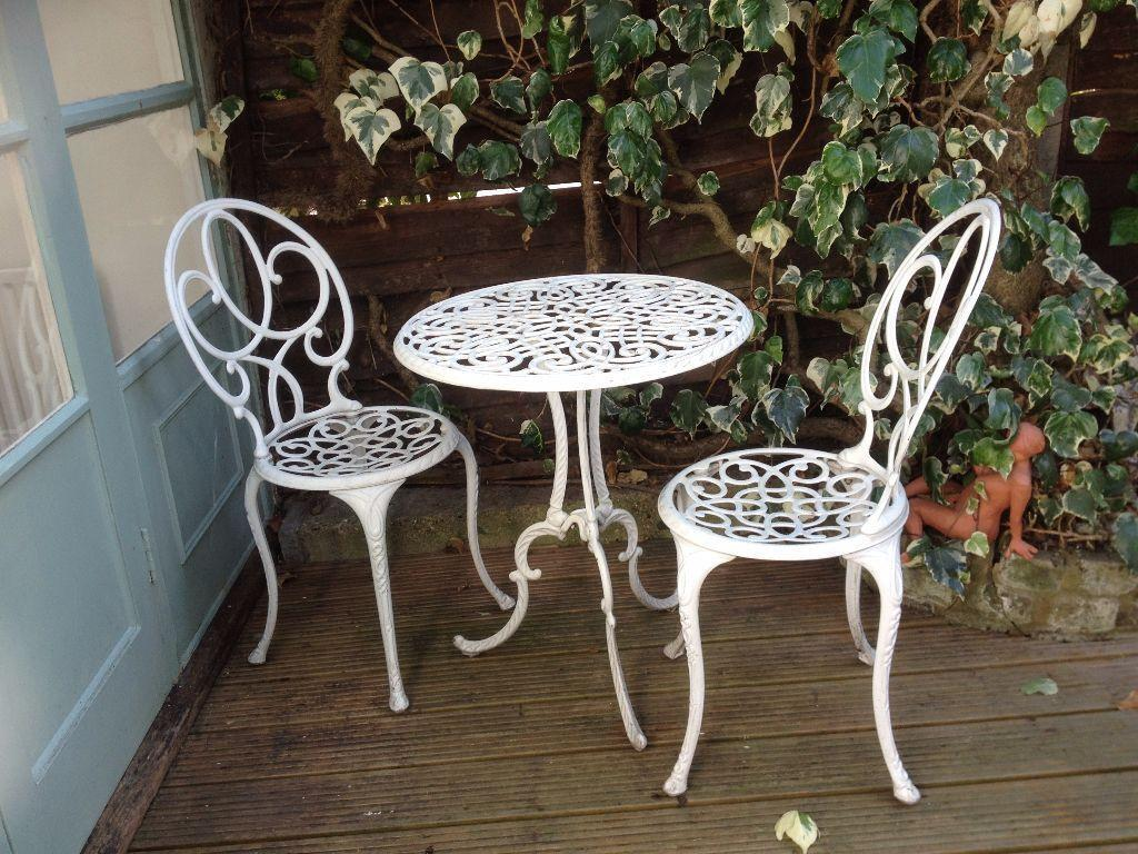Cast iron garden bistro table and two chairs white good for Outdoor furniture gumtree