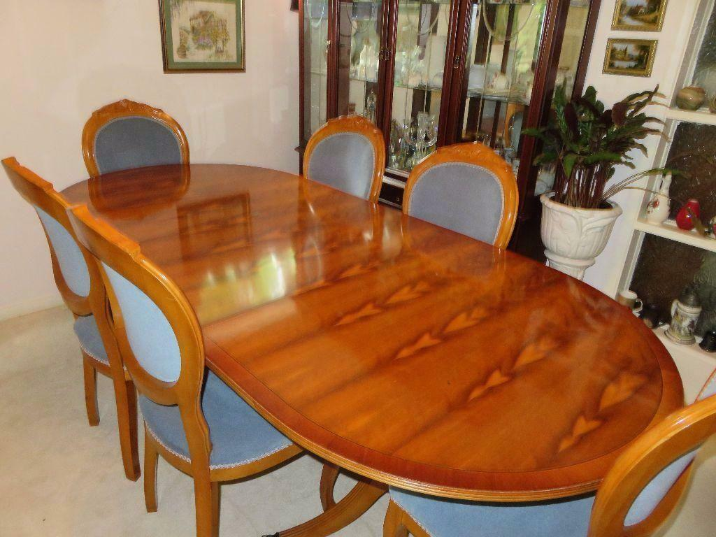 rosewood dining room table with leaf extension and 6 chairs very good