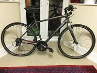 Specialized Sirrus Elite with extras. Good condition.
