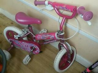 lovely pink bike /stablizers ajustable seat /handbars ex con