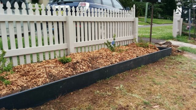 Beautiful 200mm High Black Recycled Plastic Garden Edging. Curves Easily