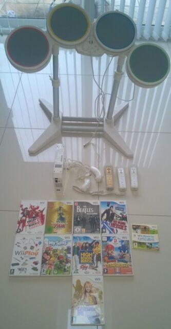Nintendo Wii 512 MB White RVL001, drum kit, 3 hand sets, 2 nunchucks, 9 games.