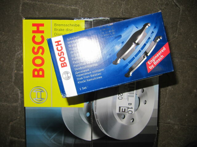 Bosch brake discs and brake lining with Warnk. Mercedes E-Class W210/S210 FRONT