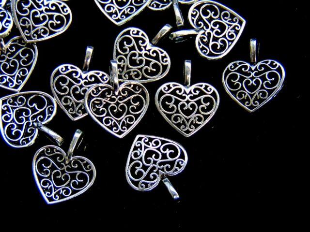 25 pcs 18mm tibetan silver filigree heart pendants charms 25 pcs 18mm tibetan silver filigree heart pendants charms jewellery s123 mozeypictures Choice Image