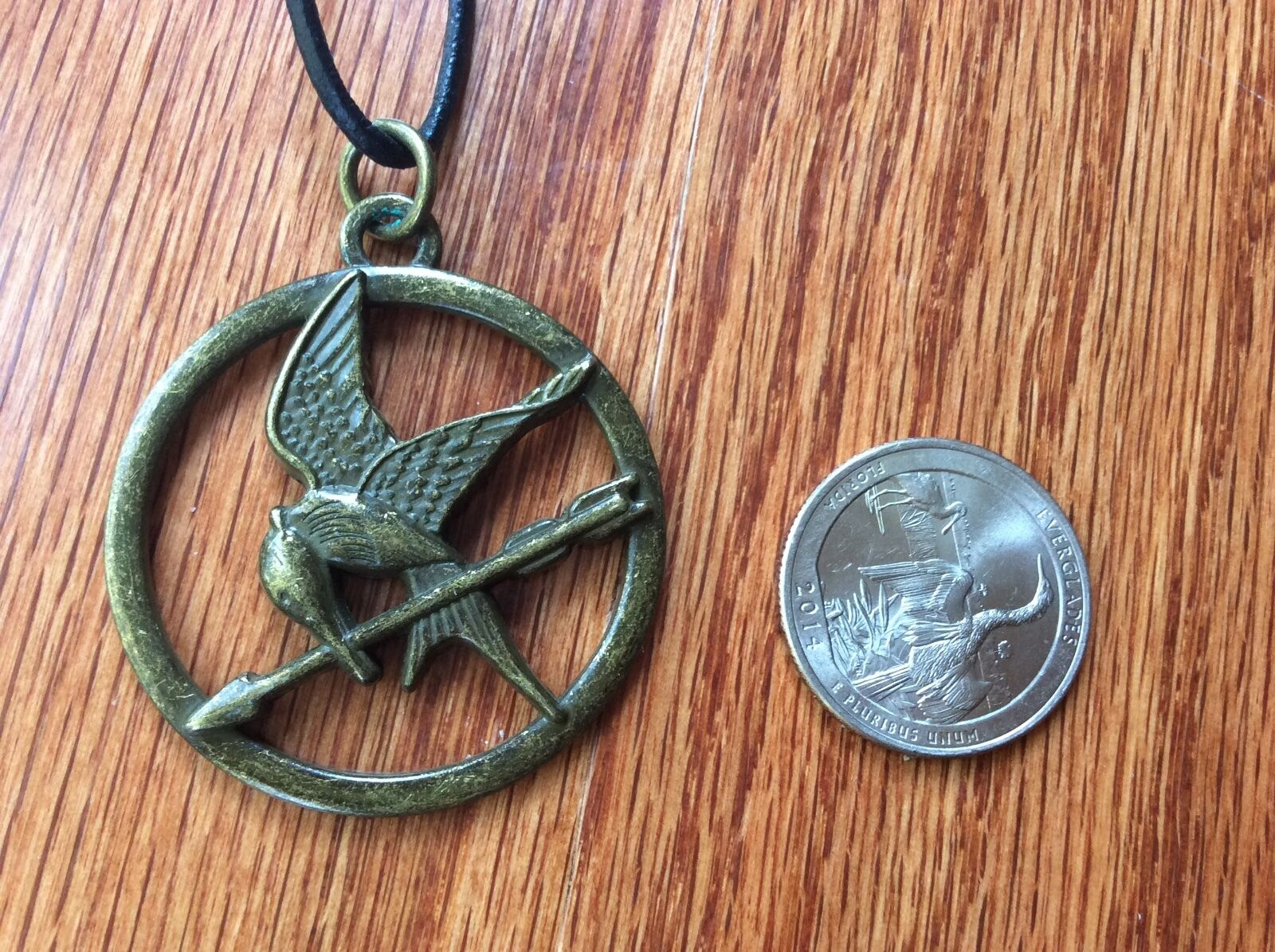 The hunger games mockingjay pendant on leather cord necklace ebay picture 1 of 4 mozeypictures Images