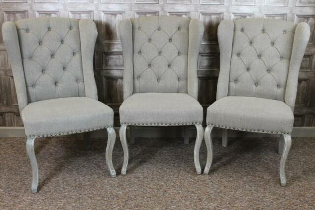 Good BUTTON BACK WINGED FRENCH STYLE DINING CHAIRS IN STONE LINEN WITH LIMED LEGS