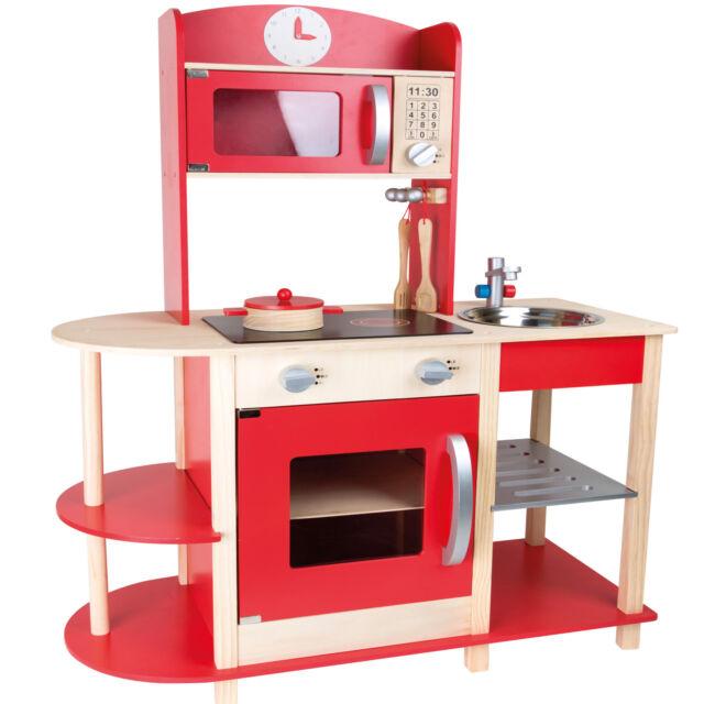 Cocina de madera roja con accesorios \